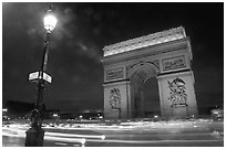 Arc de Triomphe illuminated at night. Paris, France ( black and white)