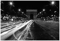 Arc de Triomphe seen from the middle of Champs Elysees at night. Paris, France ( black and white)