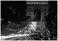 Arc de Triomphe and Champs Elysees at night with car light trails. Paris, France ( black and white)