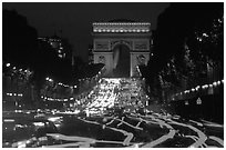 Arc de Triomphe and Champs Elysees at night. Paris, France ( black and white)