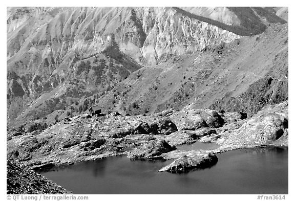 Lake and mountain hut, Mercantour National Park. Maritime Alps, France (black and white)