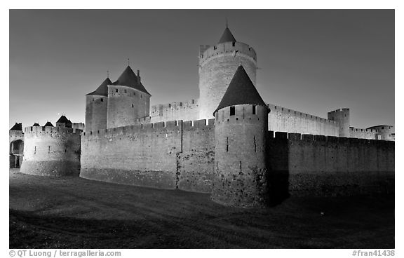 Rampart walls and stone towers. Carcassonne, France (black and white)