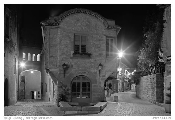 Stone buildings and streets at night. Carcassonne, France (black and white)