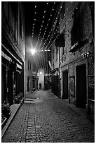 Medieval street by night with Christmas decorations and. Carcassonne, France (black and white)