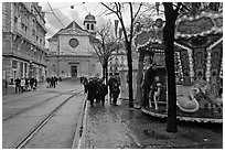 Street carousel and church. Grenoble, France ( black and white)