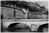 Stone bridge and brightly painted riverside townhouses. Grenoble, France ( black and white)