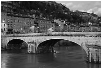Bridge and brightly painted riverside houses at dusk. Grenoble, France (black and white)