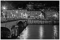 Isere River, Citadelle stone bridge and old houses at dusk. Grenoble, France ( black and white)