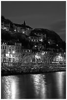 Hillside houses and Christmas lights reflected in Isere River. Grenoble, France ( black and white)