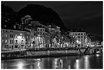 Isere River and houses below the Citadelle at night. Grenoble, France ( black and white)