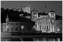 Saint Jean Cathedral and Notre Dame of Fourviere basilica at night. Lyon, France ( black and white)