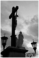Cross with Christ at sunset. Avignon, Provence, France ( black and white)