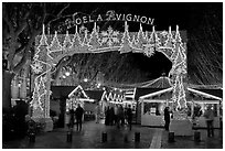 Christmas fair at night. Avignon, Provence, France (black and white)