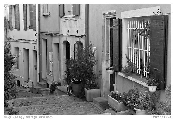 Facades of painted houses. Arles, Provence, France (black and white)