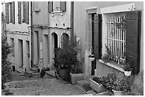 Facades of painted houses. Arles, Provence, France ( black and white)