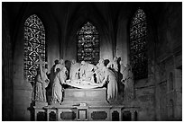 Lit sculpture of Christ laid to rest, St Trophime church. Arles, Provence, France ( black and white)