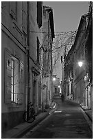 Narrow street at night. Arles, Provence, France ( black and white)