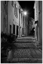 Cobblestone passageway with stepts at night. Arles, Provence, France ( black and white)
