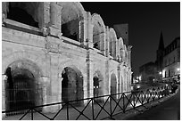 Arenes and church at night. Arles, Provence, France ( black and white)