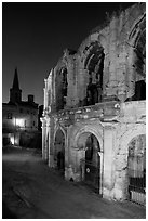 Roman arenes and church at night. Arles, Provence, France ( black and white)