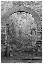 Arch opening in Thermes de Constantin. Arles, Provence, France ( black and white)