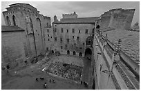 Honnor courtyard and walls from above, Palace of the Popes. Avignon, Provence, France ( black and white)