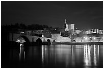 Avignon skyline at night with Papal Palace, Episcopal Ensemble and Avignon Bridge. Avignon, Provence, France (black and white)