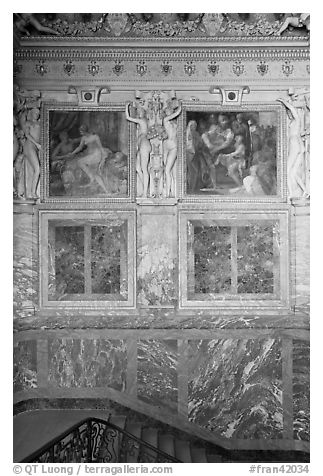 Wall decor in staircase inside Chateau de Fontainebleau. France (black and white)