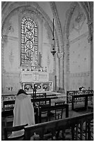 Monks praying in chapel, Saint Quiriace Collegiate Church, Provins. France ( black and white)