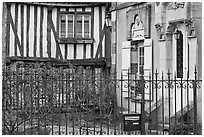 Fence, stone house, and half-timbered house, Provins. France ( black and white)