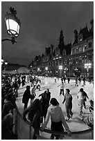 Holiday skating rink at night, City Hall. Paris, France (black and white)