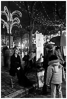 Portraitist at work, Place du Tertre, Montmartre. Paris, France (black and white)