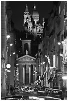 Street, Notre-Dame de Lorette Church, and Sacre-Coeur basilica, Montmartre. Paris, France (black and white)