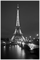 Seine River, Iena Bridge, and illuminated Eiffel Tower. Paris, France (black and white)