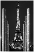 Columns of memorial to peace end Eiffel Tower by night. Paris, France ( black and white)