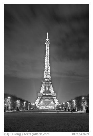 Lawns of Champs de Mars and Eiffel Tower at night. Paris, France