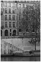 Quay and riverfront buildings on banks of the Seine. Paris, France ( black and white)