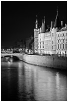 Conciergerie reflected in Seine river at night. Paris, France ( black and white)