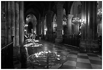 North Aisle and candles, cathedral Notre-Dame-de-Paris. Paris, France (black and white)