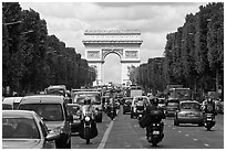 Car and motorcycle traffic and Arc de Triomphe, Champs-Elysees. Paris, France (black and white)