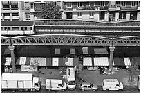 Aerial portion of metro from above, with public market stalls below. Paris, France ( black and white)