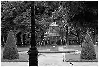 Cortot Fountain in park, place des Vosges. Paris, France ( black and white)