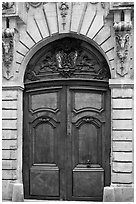 Ancient wooden door, le Marais. Paris, France ( black and white)