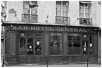 Old Bar hotel and rainbow flag. Paris, France ( black and white)