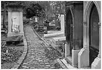 Monumental tombs in Pere Lachaise cemetery. Paris, France ( black and white)