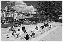 Children playing in sandbox, Place des Vosges. Paris, France ( black and white)