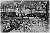 Girls playing in park, Place des Vosges. Paris, France ( black and white)