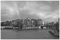 Clearing storm with rainbow above Saint Louis Island. Paris, France ( black and white)