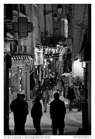 Pedestrian street with restaurants at night. Quartier Latin, Paris, France (black and white)
