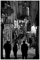 Pedestrian street with restaurants at night. Quartier Latin, Paris, France ( black and white)